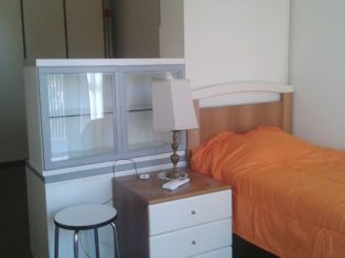 Milan, Bed in a shared room with one female guest